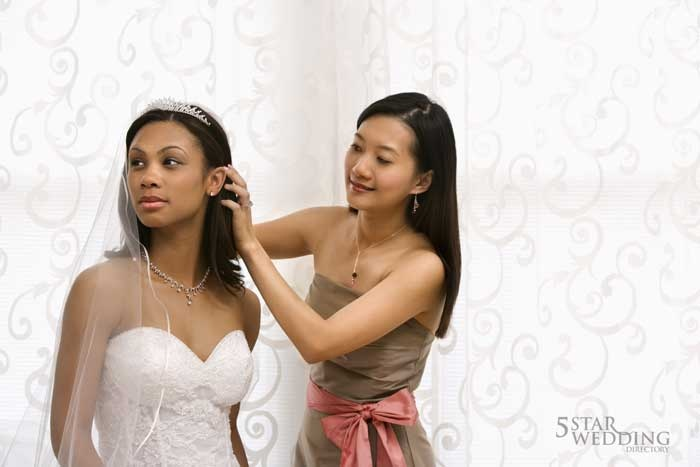 bridemaid helping bride